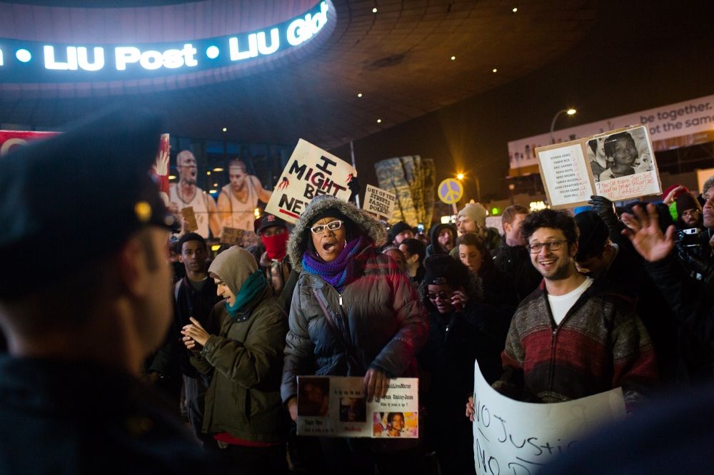 Under the bright lights of Barclay's Center in Brooklyn, Eric Garner protestors showed up in great number to demonstrate as the royal family attended a Nets game.