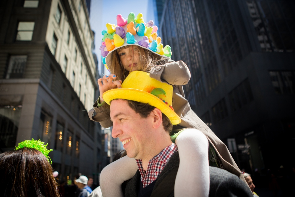 Nixie Berlinghof, age 6, on her dad Peter's shoulder's at her first Easter bonnet festival. Nixie designed her Peeps hat by herself and plans to eat the Peeps at the end of the day.