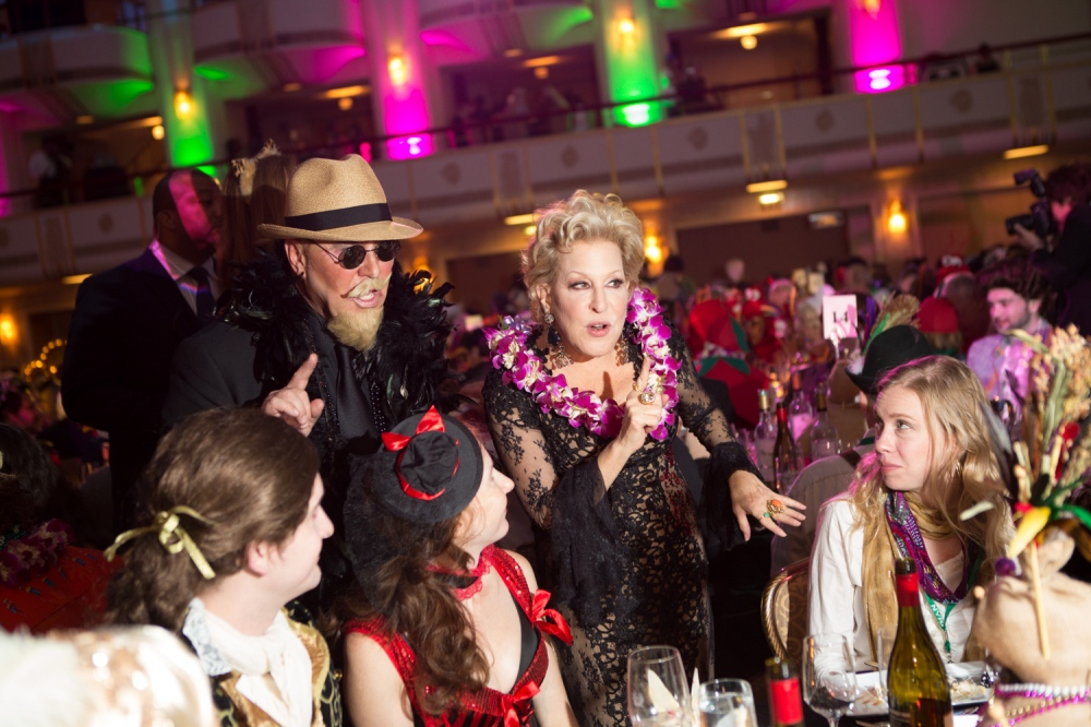 "October 31, 2013. NEW YORK, NY. Michael Kors and Bette Midler mingle with guests at the 18th Annual ""Hulaween in the Big Easy,"" Halloween gala at the Waldorf Astoria. On assignment for The Wall Street Journal"