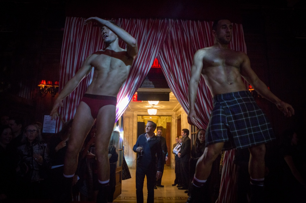 December 14, 2013. NEW YORK, NY. Dancers perform for guests at Bronson van Wyck's annual holiday party at The Oak Room in the Plaza Hotel. On assignment for The Wall Street Journal.