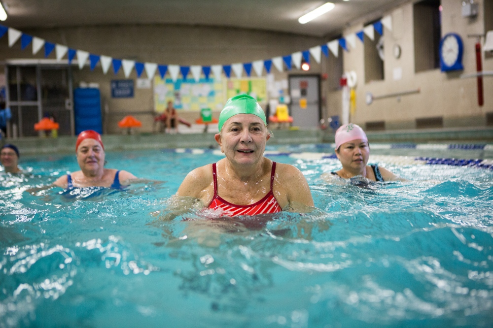 Caridad Aguirre, center, smiles as she dances underwater during her Aqua Zumba class led by instructor Daniela Grosso. Fitness instructor Daniela Grosso leads her Aqua Zumba class at the 92 Street Y on Tuesday evening. On assignment for The New York Times .