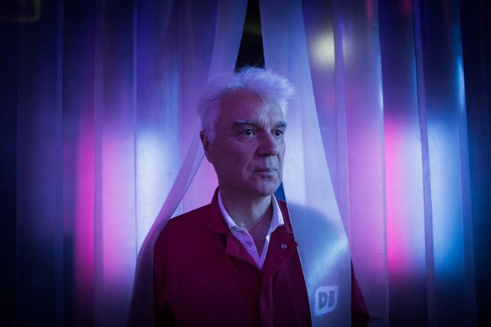"David Byrne behind stage at his musical ""Here Lies Love."""