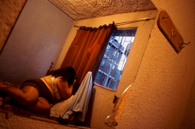 Bogota,Colombia A prostitute in her bed into a house of prostitution in the center of the city.