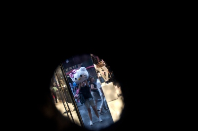 New York,US ,Self portraitright through an eye hole in the head of my Hello Kitty costume.