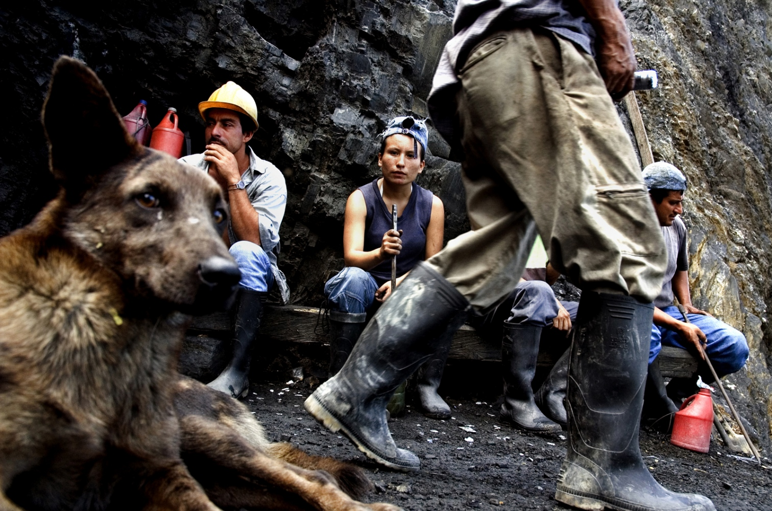 "At the entrance of the mine, a ""guaqueros"" (independent emerald mine laborer) rest and drink ""chicha""(indigenous drink base in fermented maize) after an exhausting and fruitless day in the mines. Muzo, Boyacá Colombia."