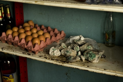 Detail of a store in which 'murralla'(Low value emeralds rocks) is easily bought and sold by the townsfolk. Chivor, Boyacá, Colombia.