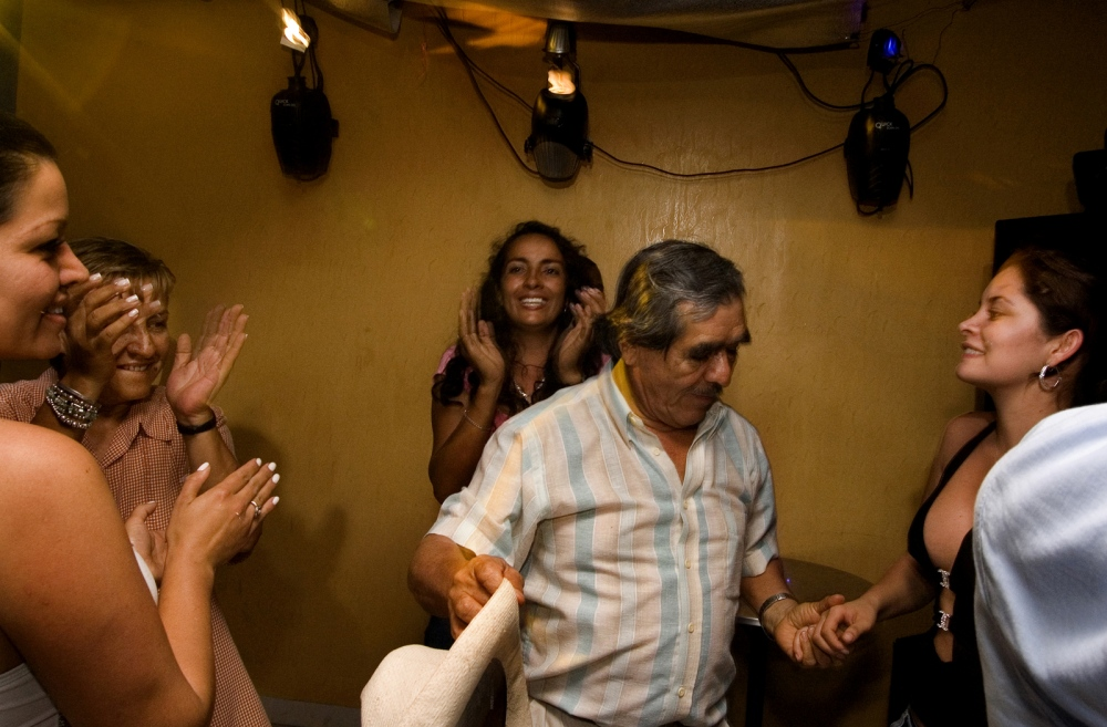 "Victor Carranza, the legendary emerald zar, parties with a group of women in a Muzo discoteque, which was closed to the public during his stay for security reasons. He was accompanied physically by a half-dozen body guards within the club, Carranza was widely understood to be the ""Patron"" (Boss), of an extensive region of central Colombia, comprising the emerald-rich department of Boyaca ( his place of origin), and large parts of neighboring Meta and Casanare departments. These areas are also active ""routes"" through which most of the Colombian cocaine exported via Venezuela passes, Carranza died of lung and prostate cancer in 2013.MUZO, BOYACA ,COLOMBIA"