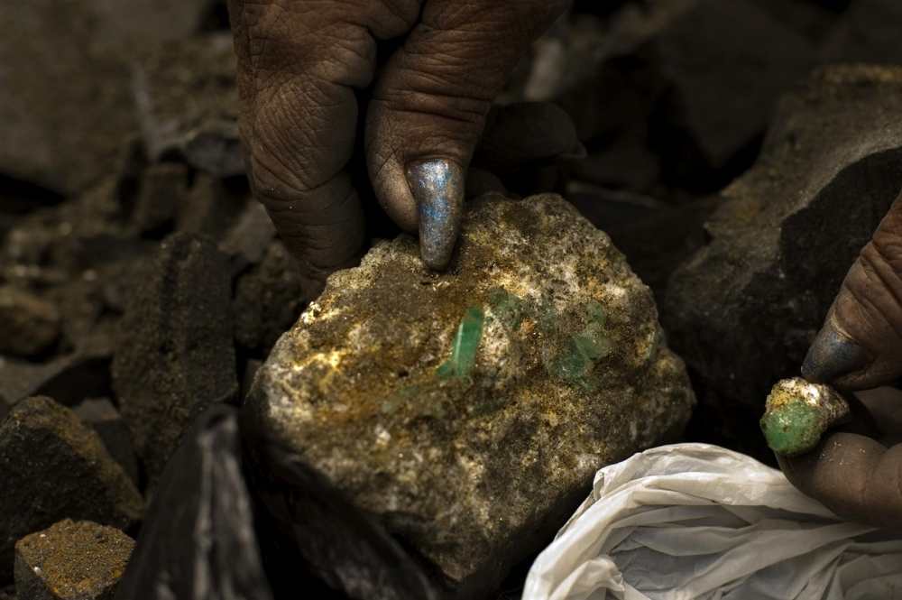 Guaqueros(Independent miner of the emerald mines) outside of a Chivor mine, where emeralds are blueish in tone and prized by dealers. Chivor , Boyacá Colombia.