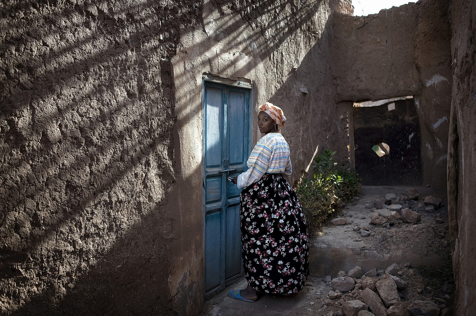 2010- Zubeida, 28, opens the door to the Synagogue which she has been the guardian of since its restoration in 2002 in the small southern Village of Irill Noro, Morocco.