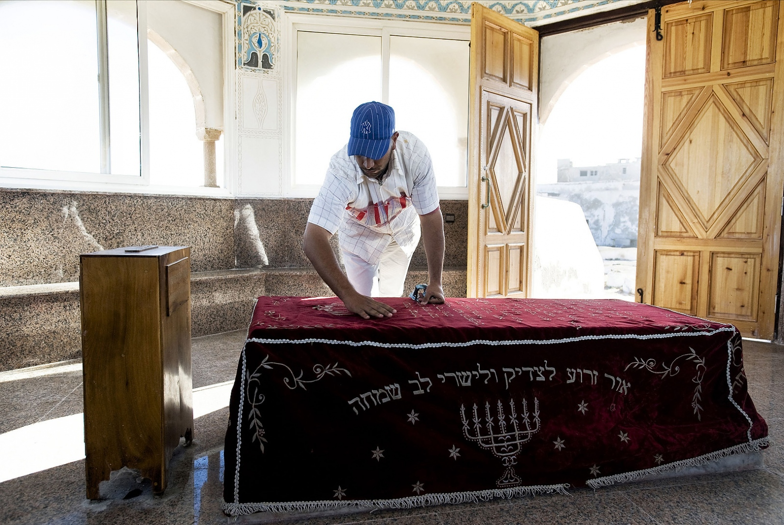 2009 - Mouhssine Arouche tends to the tomb of the Jewish saint Rabbi Haim Pinto in the 400 year old Cemetery of Essaouira. Arouche has been the guardian of the cemetery for 10 years taking over from him grandfather who performed the duty for the pervious 50 years.