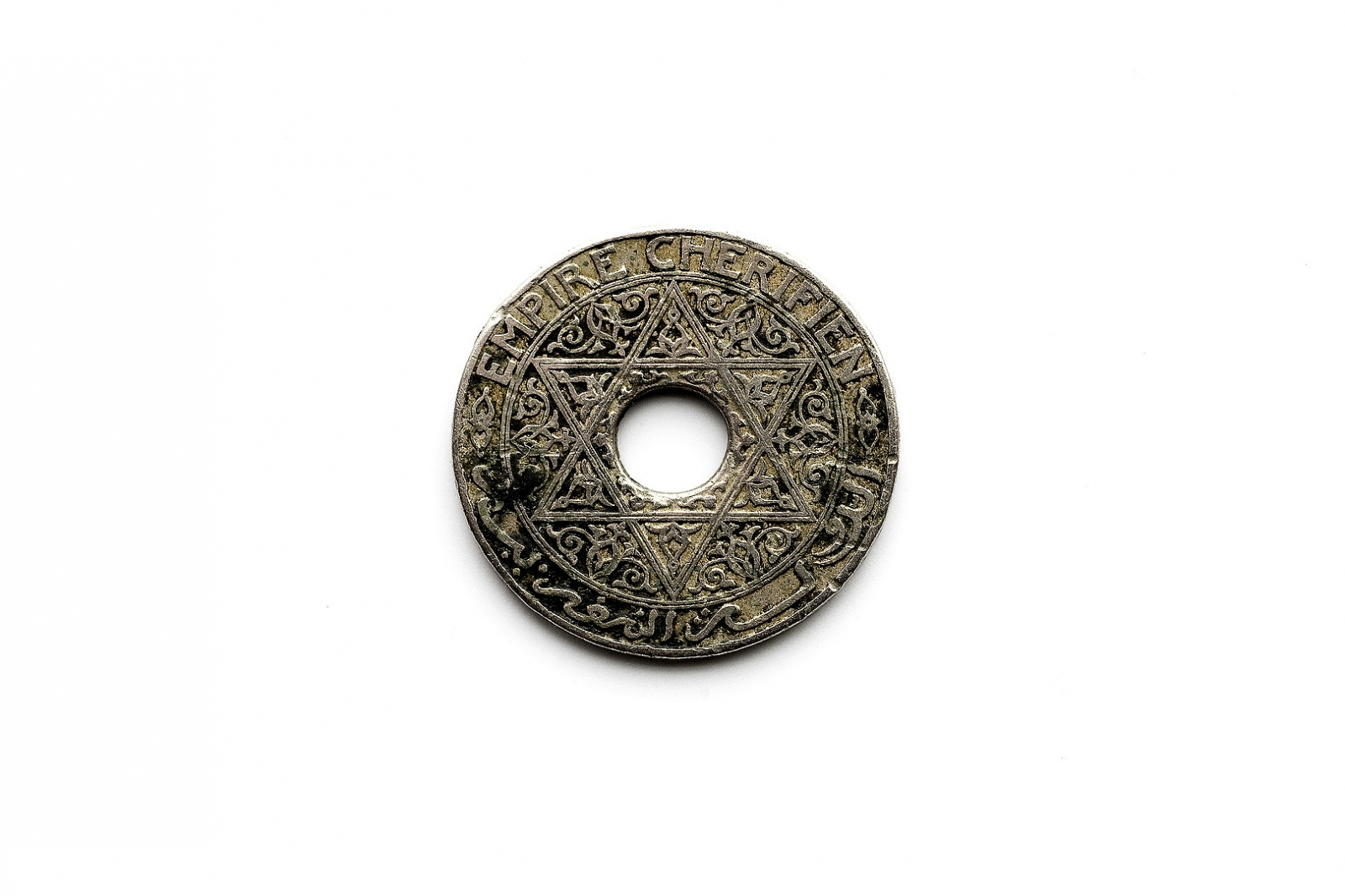 A Moroccan coin from the early 1900's. The star of David was used on Moroccan currency since the Merinid Dynasty in the 13th Century. It was replaced with the pentagram, representing the five pillars of Islam, by the occupying French government in 1915. It is thought that the change was due to rising anti-Semitism in Europe.