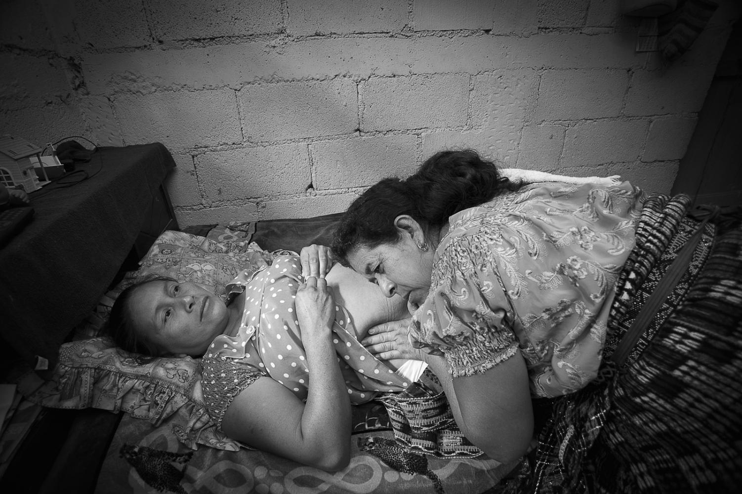 Healer Josefina Vazquez de Gonzalez examining a pregnant woman