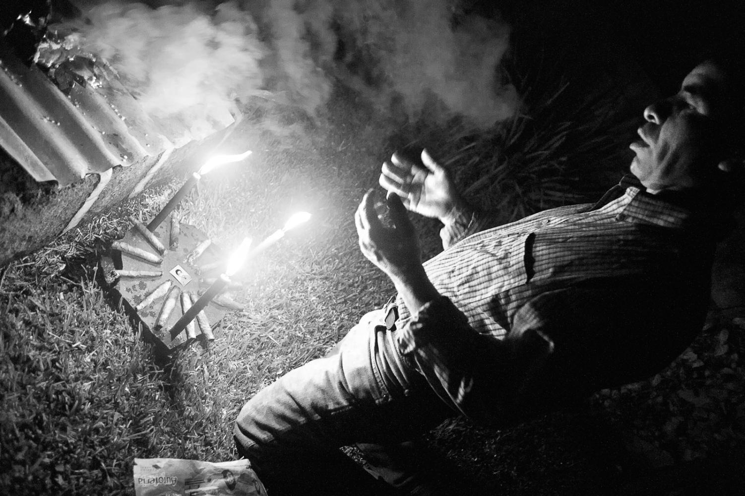 Diego Gonzalez, shaman and healerperforming a lakeside ritual healing