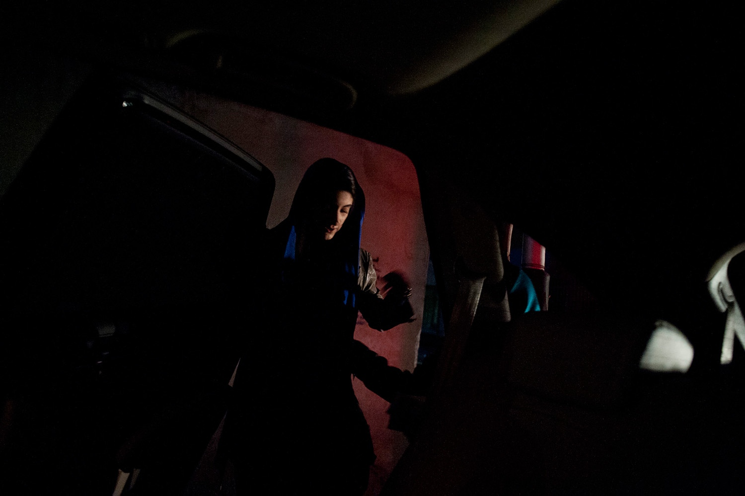 TEHRAN, IRAN - 24/12/11 – Parmida and her friend get into the car after they watch a play at Khaneh Honarmandan, in central Tehran.