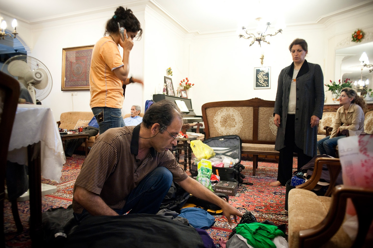 TEHRAN, IRAN - 23/06/10 – Parastou and her parents do last minute preparation and packing at home on the night of her departure to Australia, as close relatives visit them to help out or say goodbye.