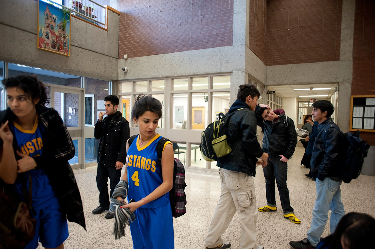 RICHMOND HILL, CANADA - 02/11/10 – Soheila plays in her school's basketball team. She and her teammates get together at the front entrance of their school to go to an afterschool game a neighboring school.