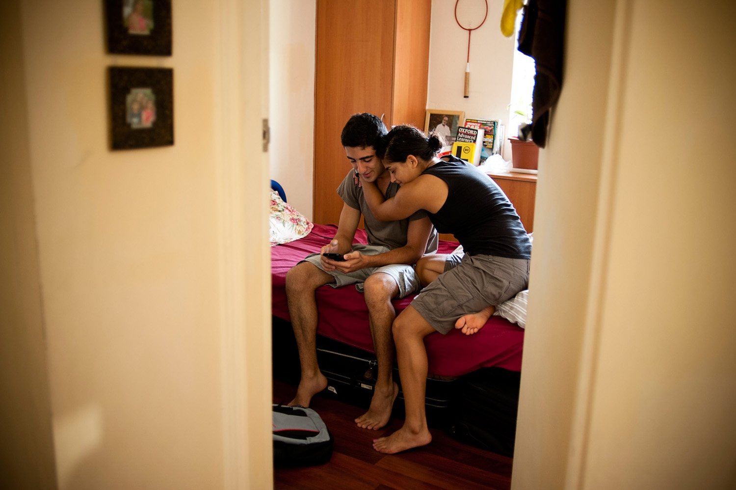 SYDNEY, AUSTRALIA - 29/01/12 - Parastou embraces her brother in his room. Soroush has now moved to Sydney to go to high school and skip the military service in Iran.