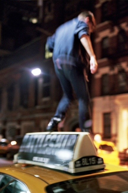 Denis climbing over a taxi, New York, NY