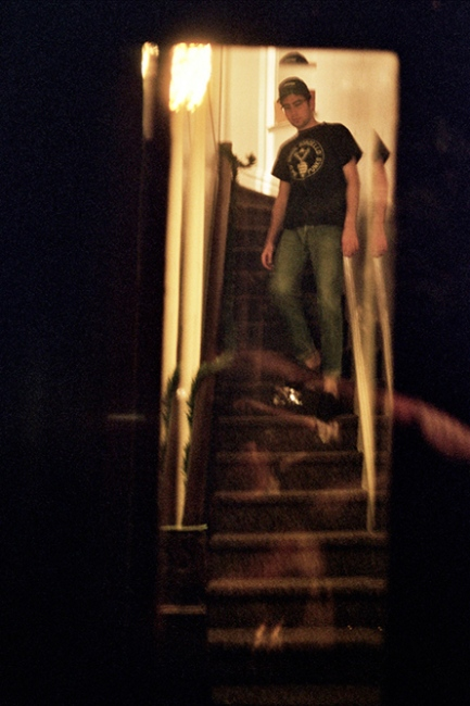 Denis coming down the stairs, Brooklyn, NY
