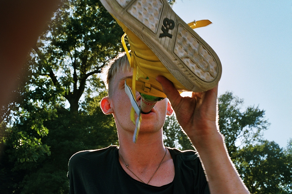 Dan drinking out of his shoe in Prospect Park, Brooklyn, NY