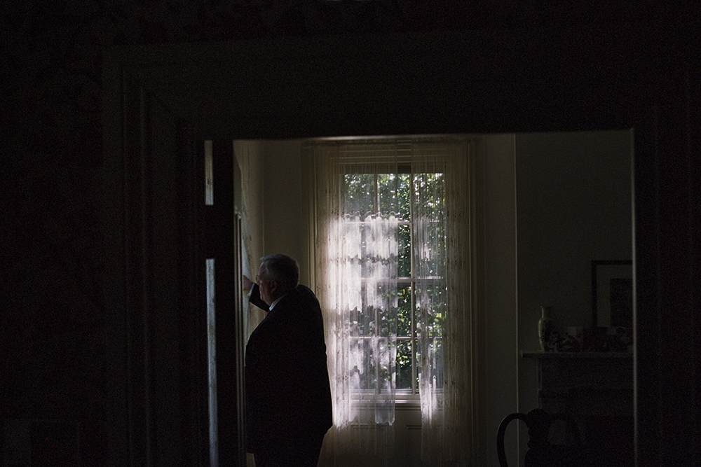 My father closeing the curtains before the funeral, Providence, RI