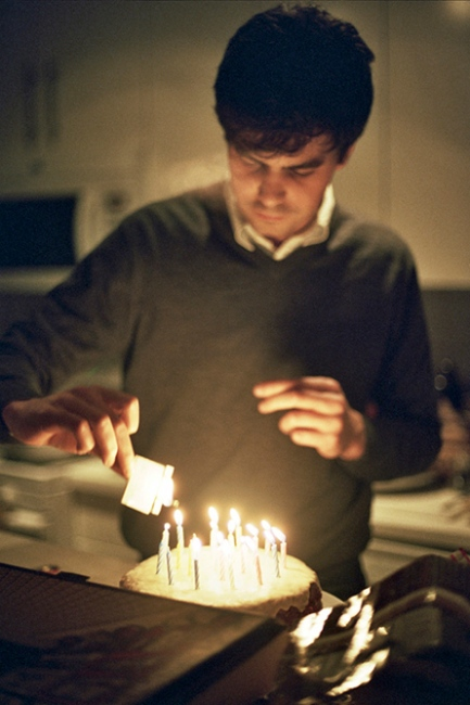 Peter lighting birthday candles, Brooklyn, NY