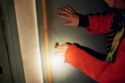 Yo opening the basement door, Paris, France
