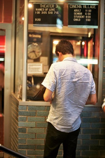 Charlie buying us movie tickets, New York, NY