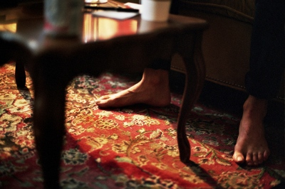 Collin's feet under the coffee table, Brooklyn, NY