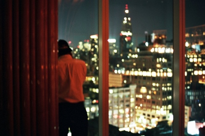 Harrison looking out the window at the BOOM BOOM ROOM, New York, NY