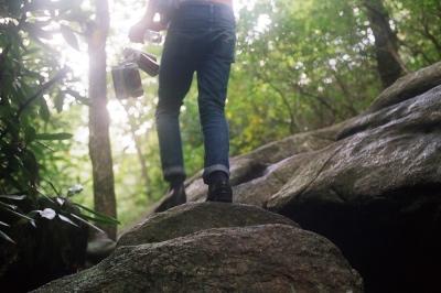 Denis climbing over rocks, Ashaway, RI