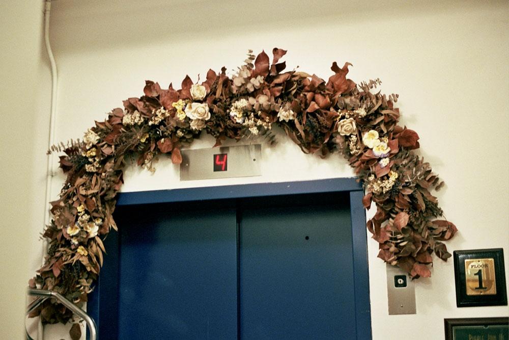 A wreath above the elevator,New York, NY