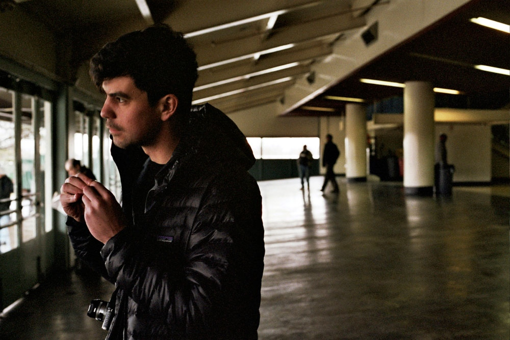 Peter rolling a cigarette at the racetrack, Queens, NY