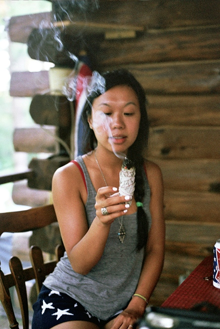 Monica burning sage in the cabin, Upstate New York