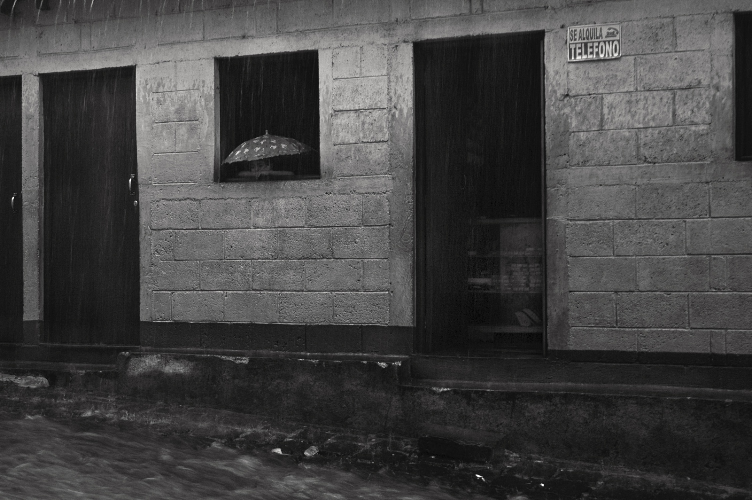 Main street in the rain, San Pedro, Guatemala