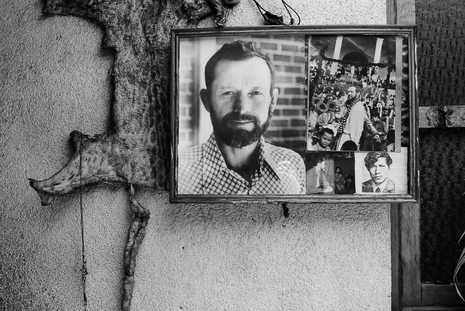 Photograph of martyred American priest Stanley Rother on a wall in Santiago Atitlán. During the war, he spoke out against the military's atrocities and gave sanctuary to those fleeing the death squads. He was killed by the army in 1981.