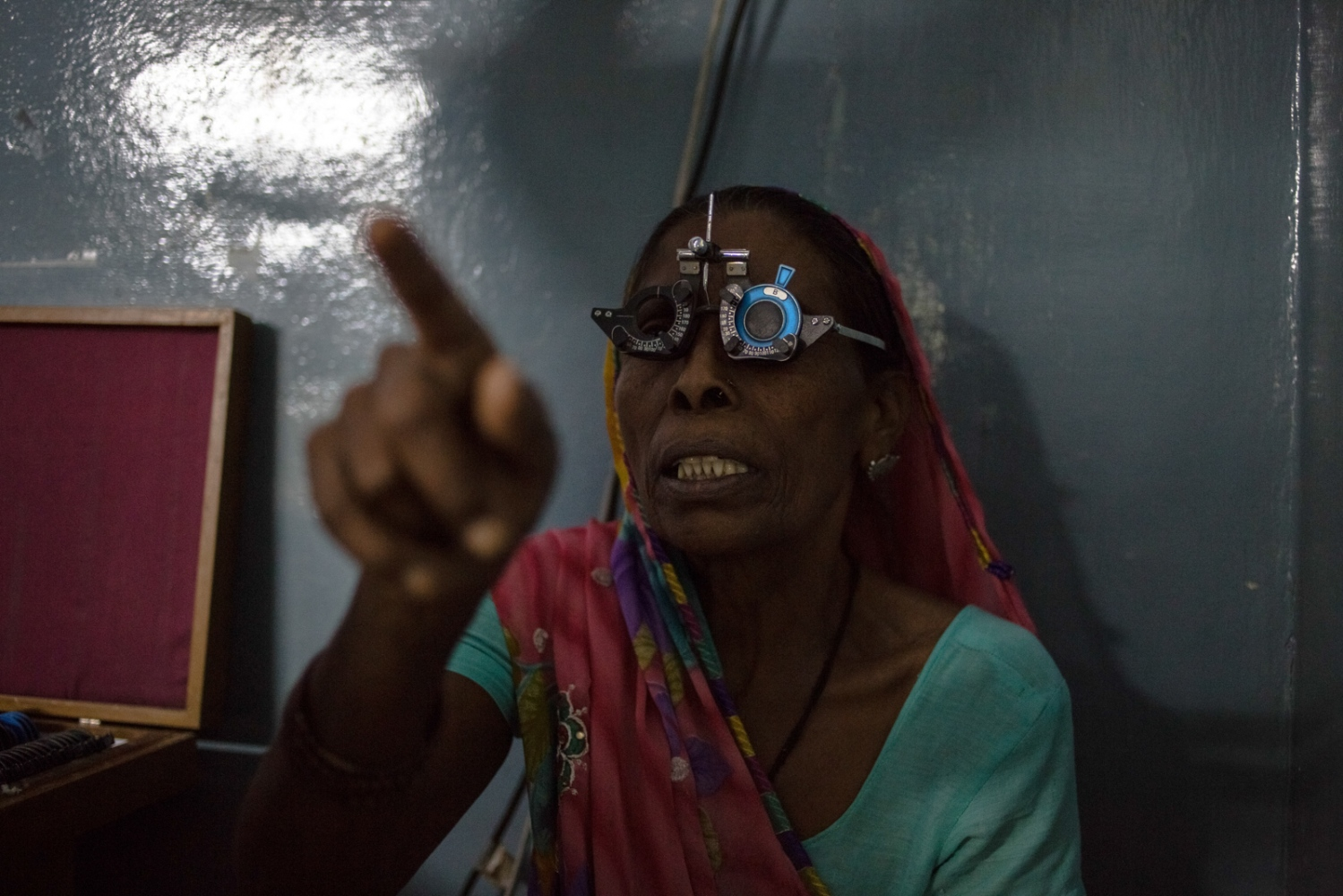 Indian patient Somoti, 65, and who goes by one name, gestures as she reads letters from a screen during an eye examination at the Dr Shroff Charity Eye Hospital Vision Centre in Malakhera village, some 30 kms from Alwar in the state of Rajasthan on August 13, 2014.