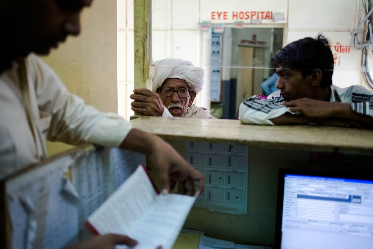 Indian patients wait in the reception area of the Dr Shroff Charity Eye Hospital in Alwar in the state of Rajasthan on August 14, 2014.