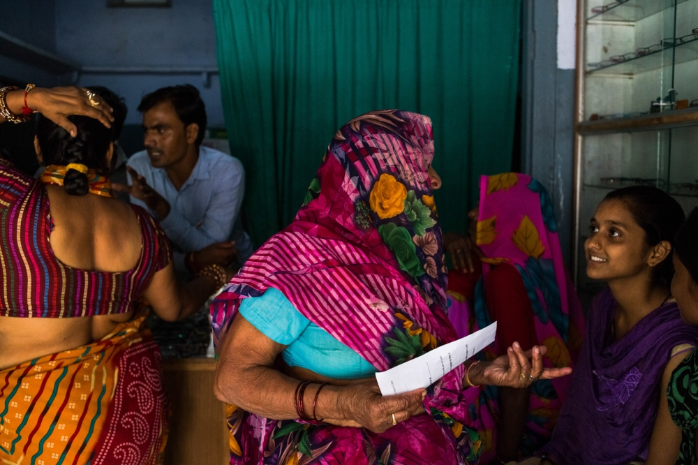 Indian patient Bhagwani (C), 65, and who goes by one name, talks to another patient waiting to be examined at the Dr Shroff Charity Eye Hospital Vision Centre in Malakhera village, some 30 kms from Alwar in the state of Rajasthan on August 13, 2014.