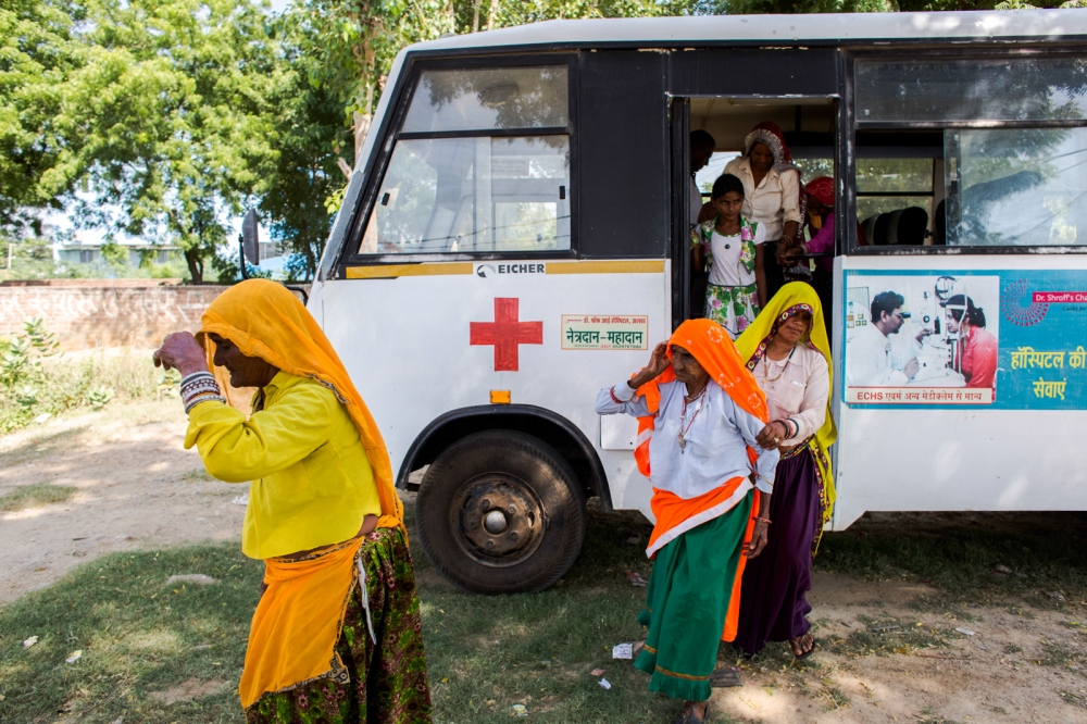 Indian patients patients referred for consultation and treatment arrive from Nagledi village, in Rajasthan's Alwar district, at the Dr Shroff Charity Eye Hospital in Alwar on September 26, 2014.
