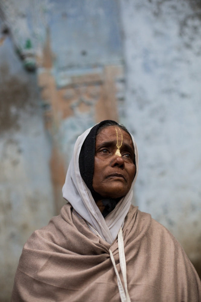 "Indian widow Mira Dasi, 62, poses for a photograph at the Meerasahabhagini Ashram in Vrindavan, some 135 kilometres (80 miles) south of New Delhi on March 5, 2014. Dasi has lived in the ashram for eight years and says, ""A person who is good can find every place good. God keeps me always happy. I can only live here in Vrindavan, not anywhere else, not even in my town in Bengal because Vrindavan is where I find God."""