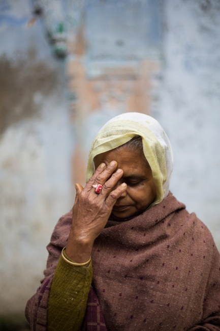 """Indian widow Shobha Dasi, 69,poses for a photograph at the Meerasahabhagini Ashram in Vrindavan, some 135 kilometres (80 miles) south of New Delhi on March 5, 2014. Dasi says, """"I've been here many years. It's good that I can be here, because I don't have any children to take care of me."""""""