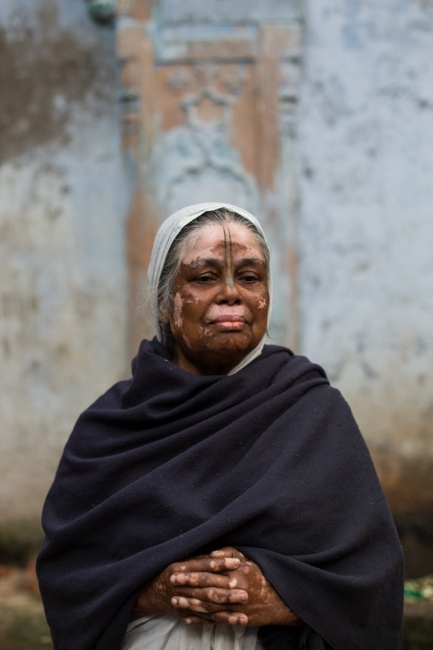 """Indian widow Shankari Dasi, 67, poses for a photograph at the Meerasahabhagini Ashram in Vrindavan, some 135 kilometres (80 miles) south of New Delhi on March 5, 2014. Dasi says, """"I have travelled everywhere in India but there is no better place than Vrindavan."""""""
