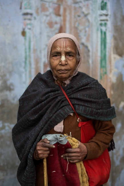 Indian widow Subhashi Sarkar, 83,poses for a photograph at the Meerasahabhagini Ashram in Vrindavan, some 135 kilometres (80 miles) south of New Delhi on March 5, 2014. Sarkar has lived at the ashram for 17 years.