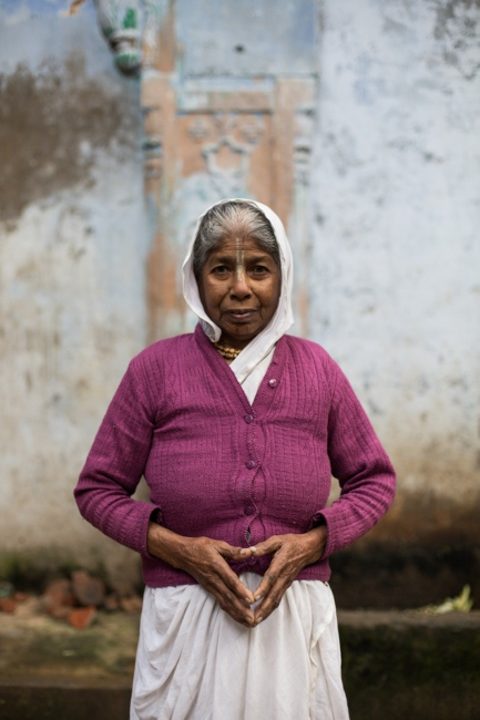 """Indian widow Anita Sarkar, 70,poses for a photograph at the Meerasahabhagini Ashram in Vrindavan, some 135 kilometres (80 miles) south of New Delhi on March 5, 2014. Sarkar has lived at the ashram for 35 years and says, """"I like our prayers here together. That's what I like most about living here."""""""