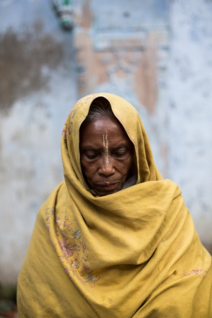 """Indian widow Mayarani Dasi, 80, poses for a photograph at the Meerasahabhagini Ashram in Vrindavan, some 135 kilometres (80 miles) south of New Delhi, on March 5, 2014. Dasi has lived at the ashram for seven years and says, """"I would never leave this ashram. It's my home."""""""