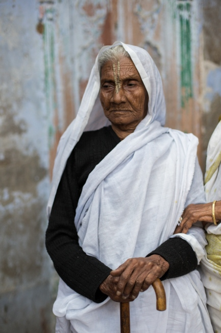 """Indian widow Savitri Dasi, 71, poses for a photographat the Meerasahabhagini Ashram in Vrindavan, some 135 kilometres (80 miles) south of New Delhion March 5, 2014. Dasi has lived at the ashram for almost 30 years and says, """"I have loved living here."""""""