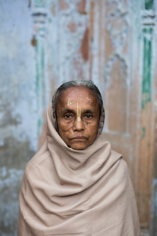 "Indian widow Lakhi Dasi, 76, poses for a photograph at the Meerasahabhagini Ashram in Vrindavan, some 135 kilometres (80 miles) south of New Delhi on March 5, 2014. Dasi has lived at the ashram for ten years and says, ""The prayers here help me to live. They bring me joy."""