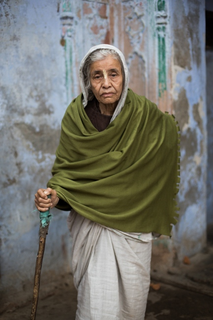 """Indian widow Saraswati Goldar, 80, poses for a photograph at the Meerasahabhagini Ashram in Vrindavan, some 135 kilometres (80 miles) south of New Delhi on March 5, 2014. Goldar has lived at the ashram for 17 years and says, """"It's so beautiful here."""""""