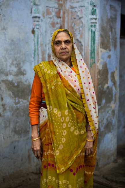 """Indian widow Urmila Tiwari, 65, poses for a photographat the Meerasahabhagini Ashram in Vrindavan, some 135 kilometres (80 miles) south of New Delhi on March 5, 2014.Tiwari has lived at the ashram for over a year and says, """"I love to live here, among good people."""""""